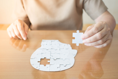 elderly woman with dementia and a jigsaw puzzle